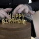 Hands of Female Confecrioner, Who Is Finishing To Put Letter Candles To the Top of Chocolate Cake, . - VideoHive Item for Sale