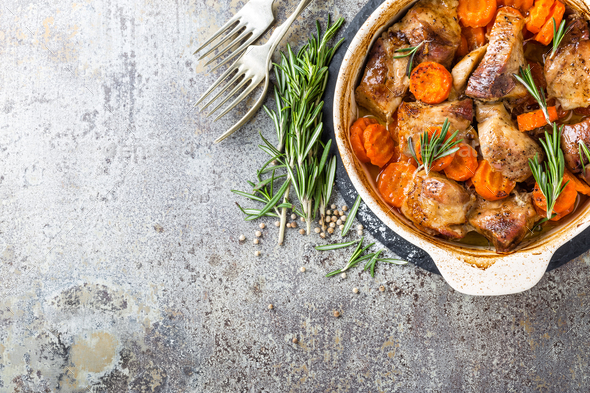 Meat baked with carrots in the oven - Stock Photo - Images