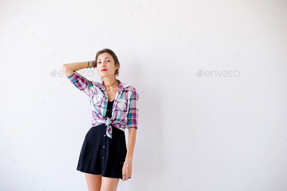 Determined model posing on white studio background - Stock Photo - Images