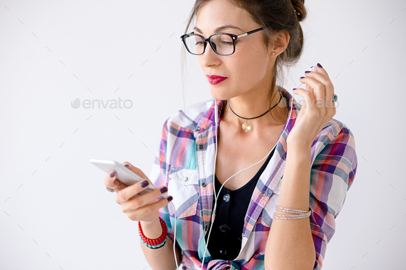 Close-up portrait of young successful woman in glasses touching - Stock Photo - Images