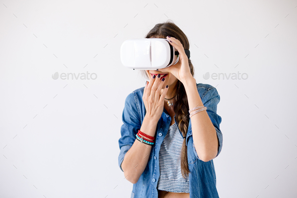 Girl portrait giggling while using VR Glasses - Stock Photo - Images