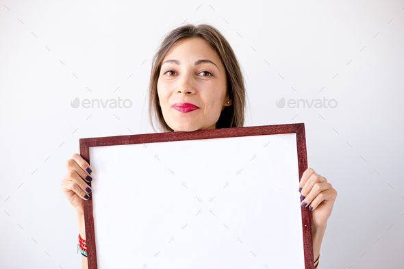 Close-up smiling girl with a display near face - Stock Photo - Images