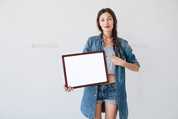 Woman with advertising frame - Stock Photo - Images