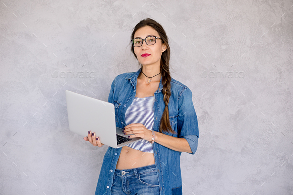 Beautiful girl with laptop in studio - Stock Photo - Images