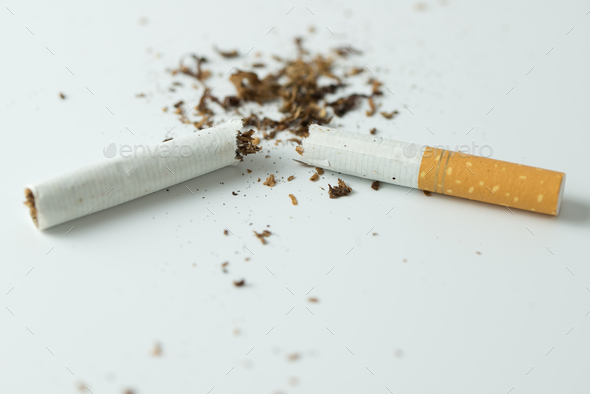 Quit smoking concept by breaking the cigarette - Stock Photo - Images