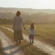 Mother with Daughter Walk on the Rural Road in the Sunset - VideoHive Item for Sale