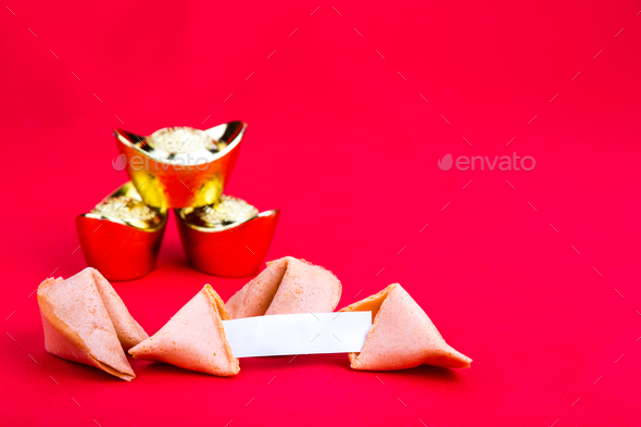 Fortune cookies with decorative gold nuggets on red background - Stock Photo - Images