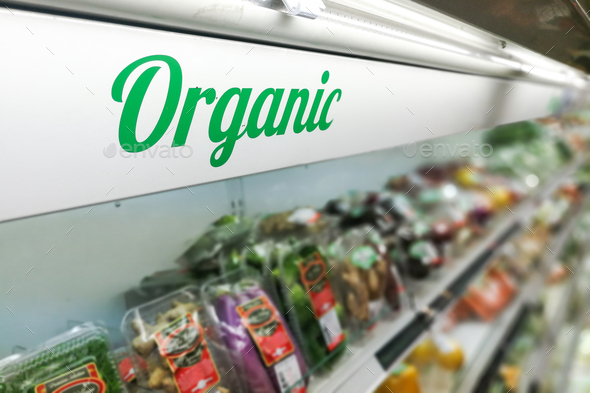Organic food signage on modern supermarket fresh produce vegetab - Stock Photo - Images