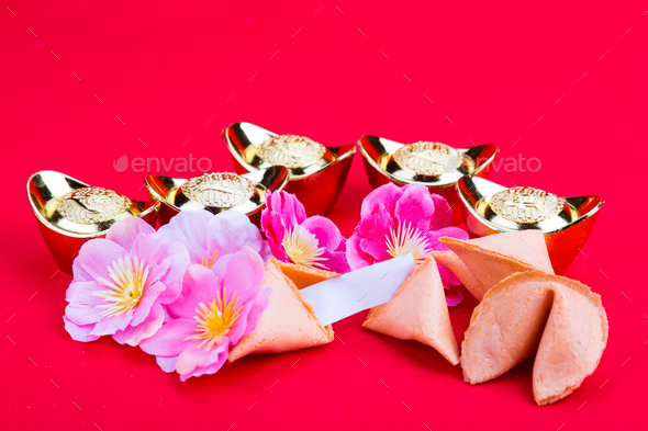 Fortune cookies, decorative gold nuggets, plum blossom flowres r - Stock Photo - Images