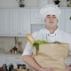 Male Cook Smiling and Posing with a Shopping Paper Bag Full of Ingridients - VideoHive Item for Sale