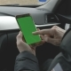 GREEN SCREEN Man Holding His Smartphone in a Car - VideoHive Item for Sale