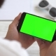 Black Smartphone Horizontally with Green Screen for Chroma Key Compositing the Hands of a Man - VideoHive Item for Sale