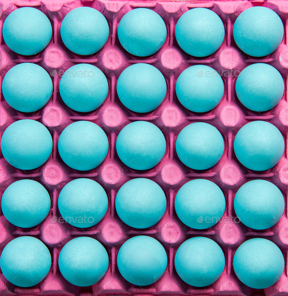 Flat lay creative blue eggs in punk tray - Stock Photo - Images