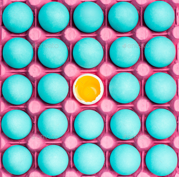 Tray with blue eggs and one with yolk - Stock Photo - Images