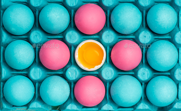 Pastel eggs painted in tray, vibrant design - Stock Photo - Images