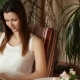 Young Beautiful Girl Reading a Book Sitting in a Chair. Attractive Woman Smiling While Reading - VideoHive Item for Sale