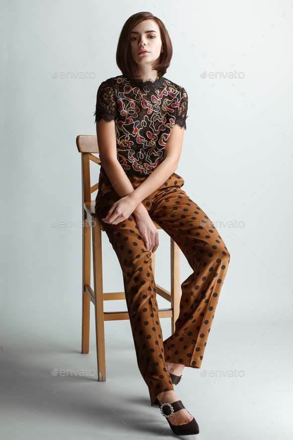 vintage fashion female model on studio background - Stock Photo - Images