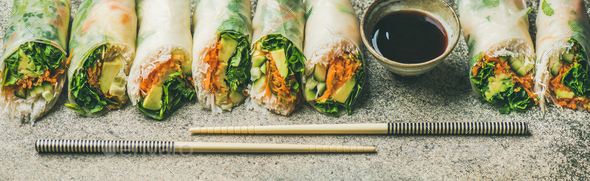 Vegan spring rice paper rolls over concrete background - Stock Photo - Images
