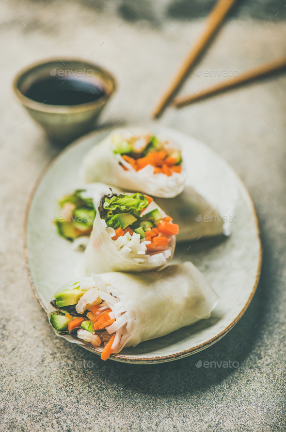 Shrimp and vegetable rice paper spring rolls on ceramic plate - Stock Photo - Images