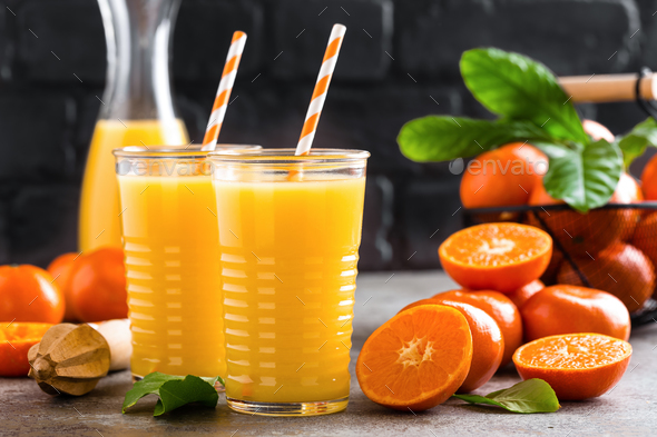 Mandarin orange juice. Refreshing summer drink. Fruit refreshment beverage - Stock Photo - Images