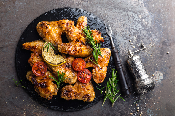 BBQ chicken wings, spicy grilled meat - Stock Photo - Images