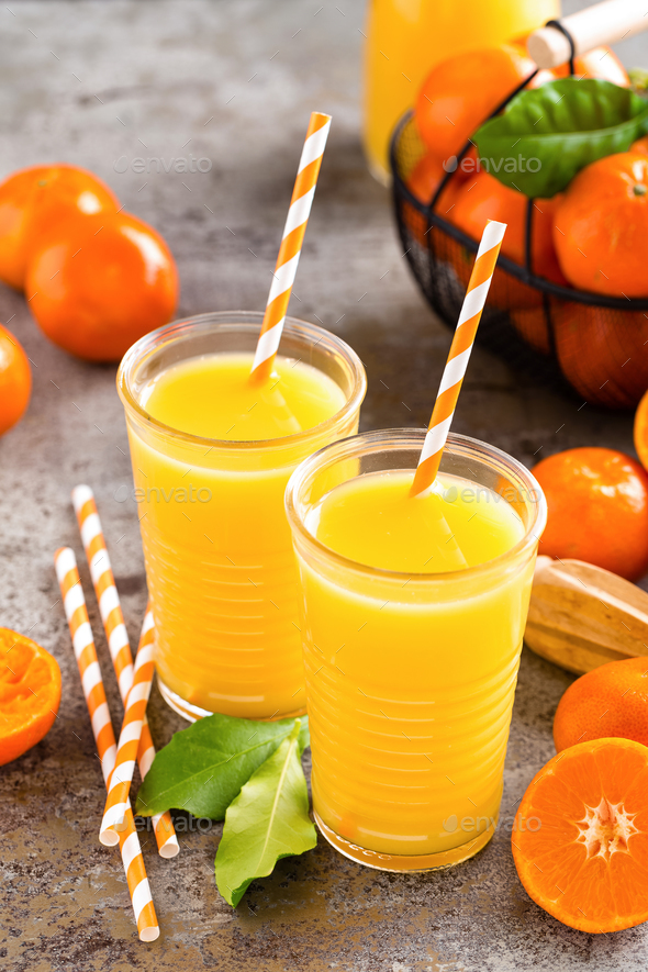 Mandarin orange juice. Refreshing summer drink. Fruit refreshment beverage - Stock Photo - Images