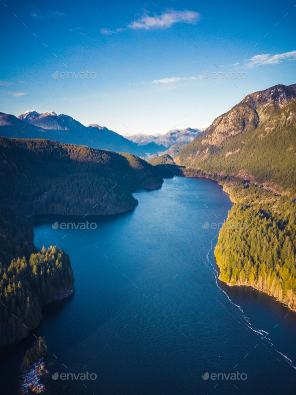 Aerial view of Lake surrounded by Trees and Mountains near Vanco - Stock Photo - Images