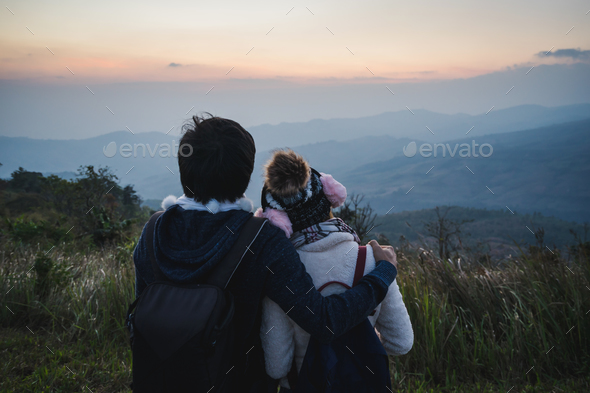 Loving couple embracing on the mountain at sunset. - Stock Photo - Images