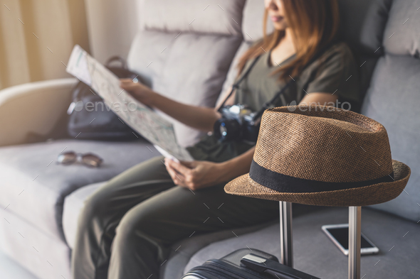 Young woman traveler using smart phone and looking map - Stock Photo - Images