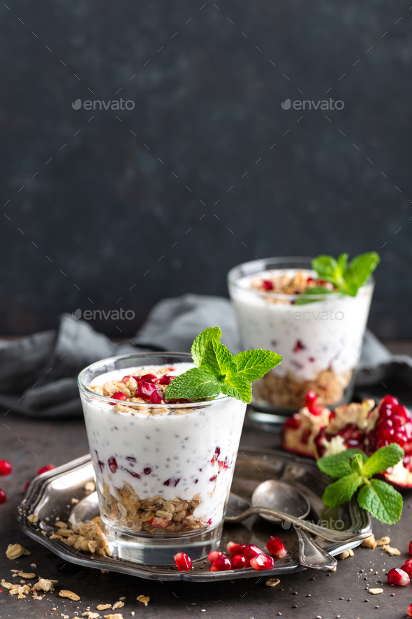 Chia pudding parfait with pomegranate, granola and light greek yogurt. Healthy eating - Stock Photo - Images