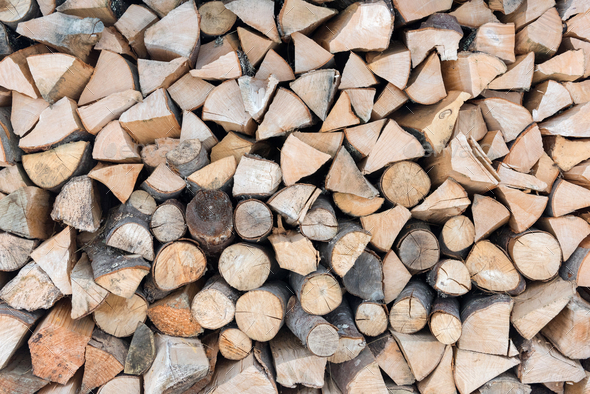 Folded firewood. Old firewood for the fireplace - Stock Photo - Images