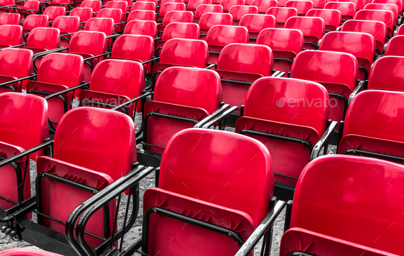 Empty plastic red chairs In outdoor theater - Stock Photo - Images