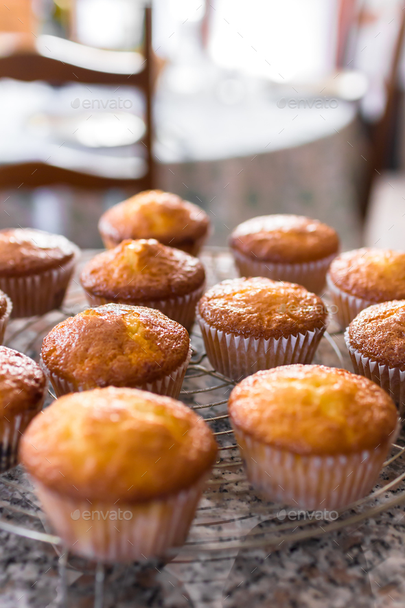 Batch of homemade freshly baked cupcakes or muffins - Stock Photo - Images