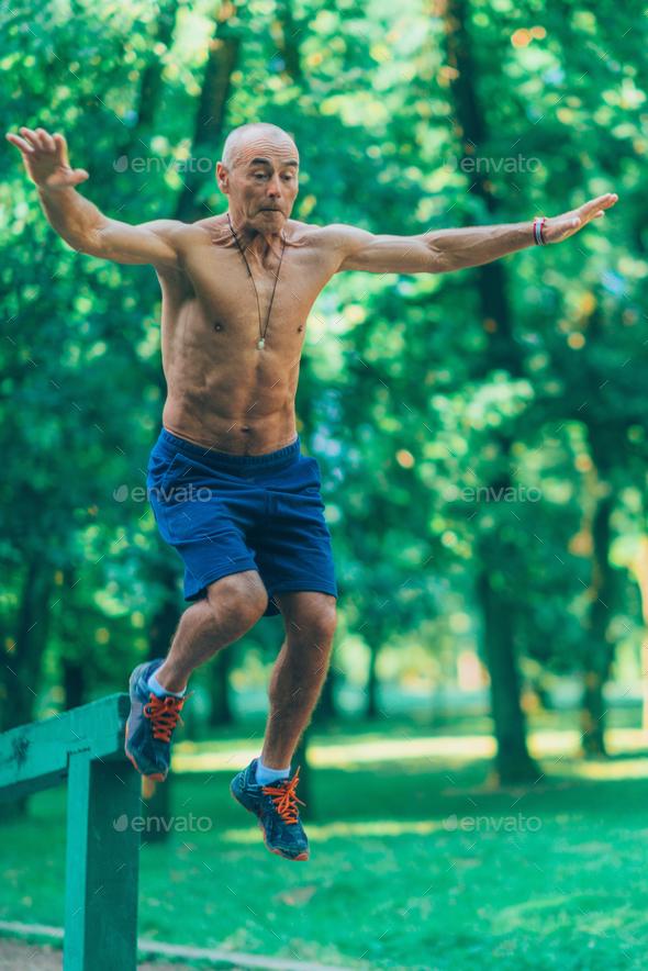 Outdoor exercising senior   - Stock Photo - Images