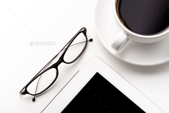 White tablet, coffee cup and glasses on a white table - Stock Photo - Images
