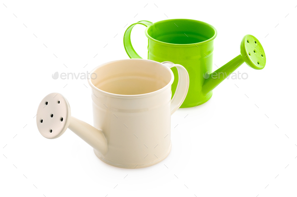 White and green watering cans - Stock Photo - Images