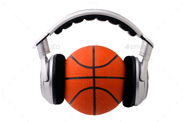 Headphones on a basketball ball - Stock Photo - Images