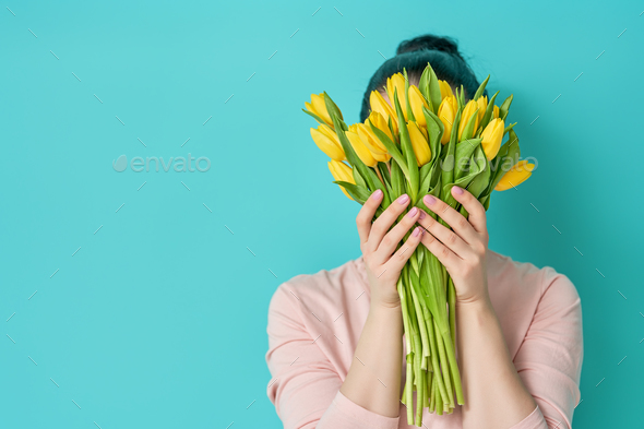 woman with flowers - Stock Photo - Images
