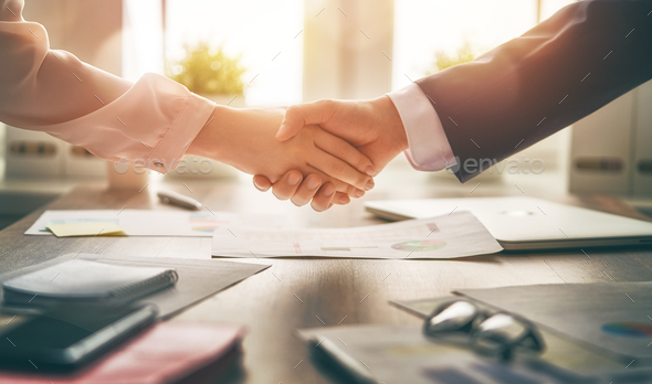 handshaking in office - Stock Photo - Images