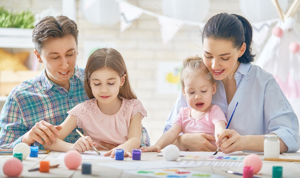 Mother, father and daughters painting - Stock Photo - Images