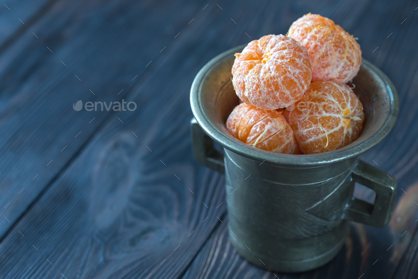 Peeled tangerines in the vintage cup - Stock Photo - Images