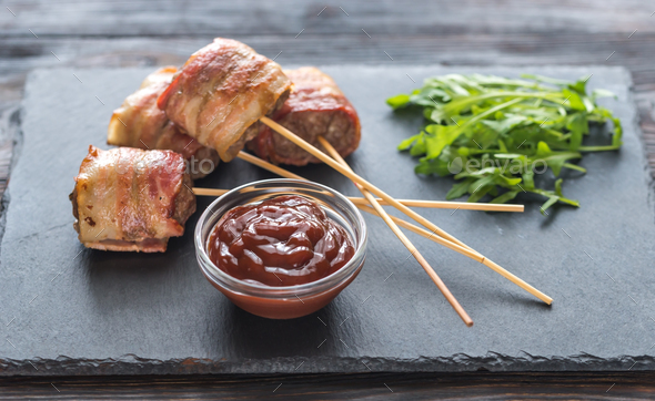 Bacon-wrapped beef skewers  - Stock Photo - Images