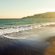 Sea waves and sandy beach at sunset. Toned and saturated image - PhotoDune Item for Sale
