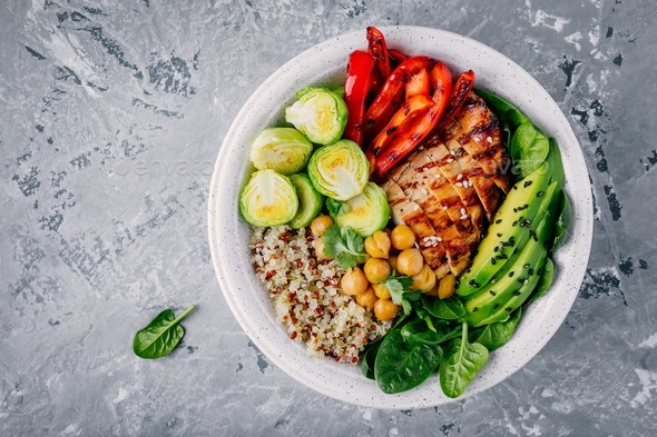 bowl lunch with grilled chicken and quinoa, spinach, avocado, brussels sprouts, chickpea - Stock Photo - Images