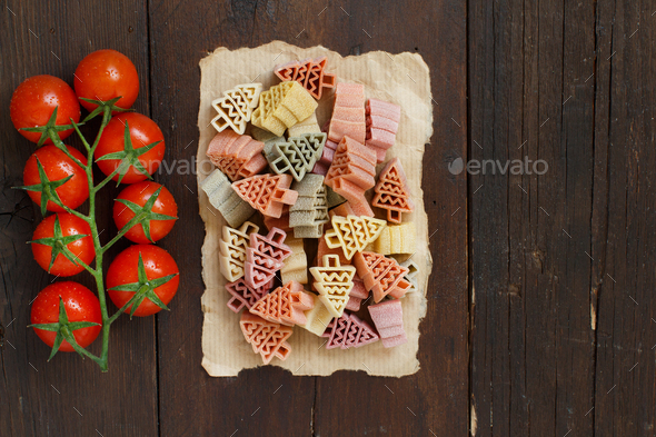 Tricolor fir tree shaped pasta and tomatoes - Stock Photo - Images