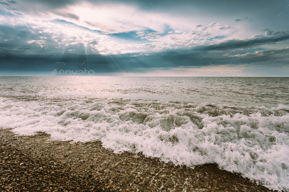Sea Ocean Waves Washing Pebble Stones Beach At Cloudy Summer Eve - Stock Photo - Images