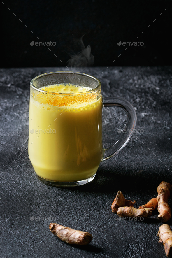 Turmeric golden milk latte - Stock Photo - Images