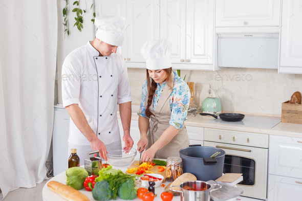 Two chefs are working together. - Stock Photo - Images