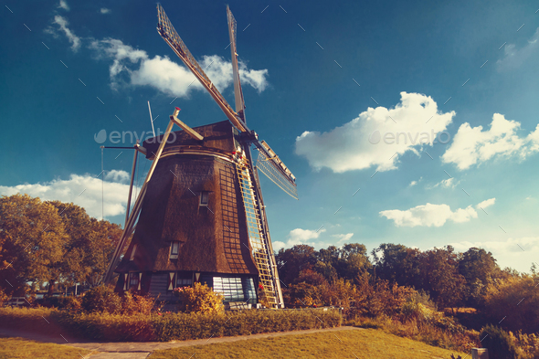Old wooden windmill in Amsterdam, Netherlands - Stock Photo - Images
