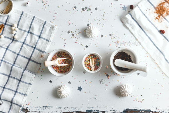 Three saucer with candy sprinkles, surrounded by sweets. Top View - Stock Photo - Images